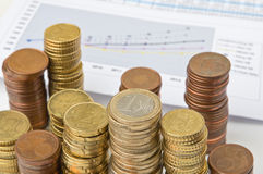 Stack of coins and prediction chart stock image