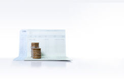 Stack of coins on saving bank accound book on the white backgrou Stock Photography