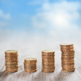 Stack coins with sky background Stock Images