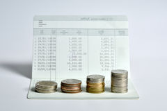 Stack of coins step up on bank saving account book Royalty Free Stock Photo