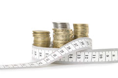 Stack of coins and tape measuring Royalty Free Stock Image