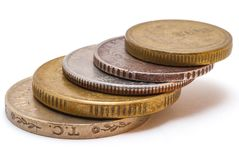 A stack of 5 coins of varying denomination and from varying countries. A stack of 5 coins of varying denomination and from varying countries including Turkey stock images