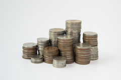 Stack of coins on white background Royalty Free Stock Photography
