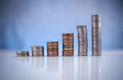Stack of coins on white floor againt with blur bokeh. Background business concept royalty free stock photography
