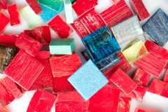 Stack of coloful glass mosaic tiles on white Stock Images