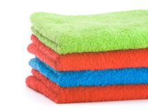 Stack of color towels. Isolated over white background Royalty Free Stock Photography