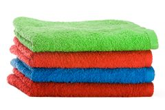 Stack of color towels. Isolated over white background Royalty Free Stock Images