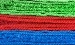 Stack of color towels. Isolated over white background Royalty Free Stock Photos