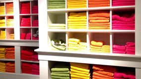 Stack of color towels on display. stock video footage