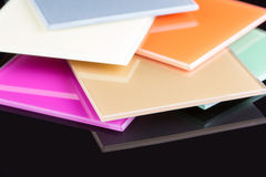 A stack of colored glass on a black background. Design, glass sheets Stock Photography