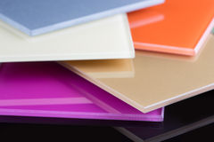 A stack of colored glass on a black background. Design, glass sheets Stock Photo