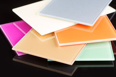 A stack of colored glass on a black background. Design, glass sheets Royalty Free Stock Photos