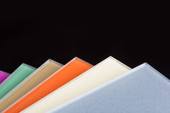 A stack of colored glass on a black background Royalty Free Stock Images