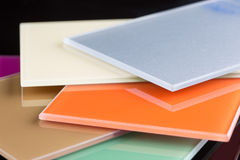A stack of colored glass on a black background. Design, glass sheets Stock Images