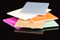 A stack of colored glass on a black background. Design, glass sheets Royalty Free Stock Image