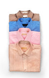 Stack of colored men's shirts Stock Image