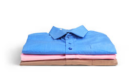 Stack of colored men's shirts Royalty Free Stock Photo
