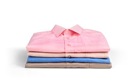 Stack of colored men's shirts Stock Images