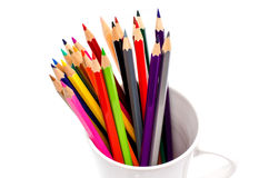 Stack of colored pencils in a glass on white background Royalty Free Stock Images