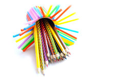 A stack of colored pencils on white background Stock Photo