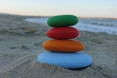 Stack of colored stones on the beach stock images