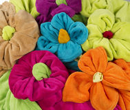 Stack of colored terry towel shape of a flower Stock Photo