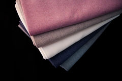 Stack of colored woolen fabrics Stock Image