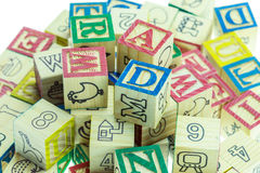 Stack of colorful alphabet blocks isolated on white Stock Photos