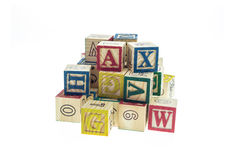 Stack of colorful alphabet blocks isolated on white. Background Royalty Free Stock Photo