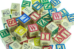 Stack of colorful alphabet blocks isolated on white Stock Images