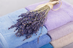 Stack of colorful bath towels on light background. stock photos