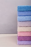 Stack of colorful bath towels on light background. Stock Photography