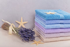Stack of colorful bath towels on light background. Stock Image