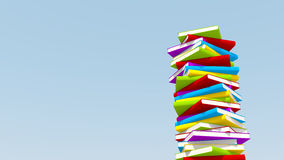Stack of colorful books against blue sky, Royalty Free Stock Images