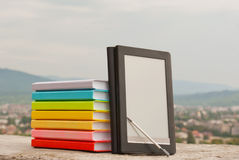 Stack of colorful books with e-book reade Royalty Free Stock Images