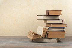 Stack of colorful books. Education background. Back to school. Book, hardback colorful books on wooden table. Education stock photo