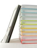 Stack of colorful books and electronic book reader Stock Image