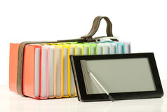 Stack of colorful books and electronic book reader Royalty Free Stock Images