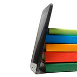 Stack of colorful books and electronic book reader. Electronic library concept. Back to school. Copy space Stock Photo