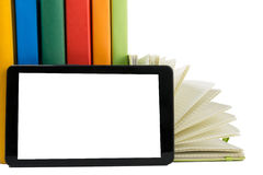 Stack of colorful books and electronic book reader. Electronic library concept. Back to school. Copy space Royalty Free Stock Photos