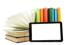 Stack of colorful books and electronic book reader. Electronic library concept. Back to school. Copy space Royalty Free Stock Photo