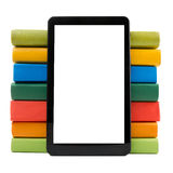 Stack of colorful books and electronic book reader. Electronic library concept. Back to school. Copy space Stock Image