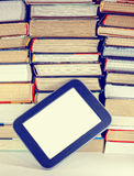 Stack of colorful books and electronic book reader. Stock Images