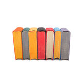 Stack of colorful books isolated on white background. Seven hardcover volumes. red black yellow pages. stock photography