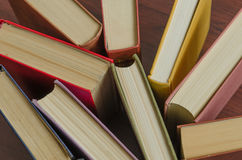 A stack of colorful books in a library Royalty Free Stock Images