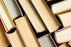 A stack of colorful books in a library Royalty Free Stock Photo