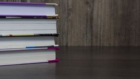 Stack of colorful books for study on wooden table, education, student, student, College, University royalty free stock photo