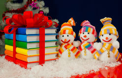 Stack of colorful books and three snowmen Stock Photography
