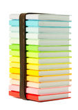 Stack of colorful books on white Stock Image
