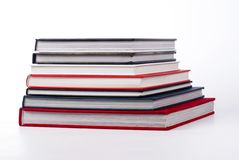 Stack of colorful books on white Royalty Free Stock Images